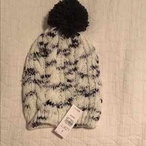 White and navy blue winter hat with Pom Pom